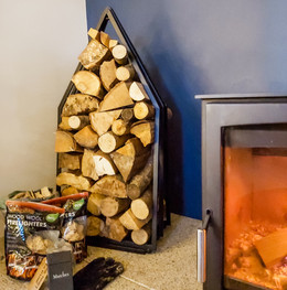 Cosy log burner, with plenty of logs for your first fire or two