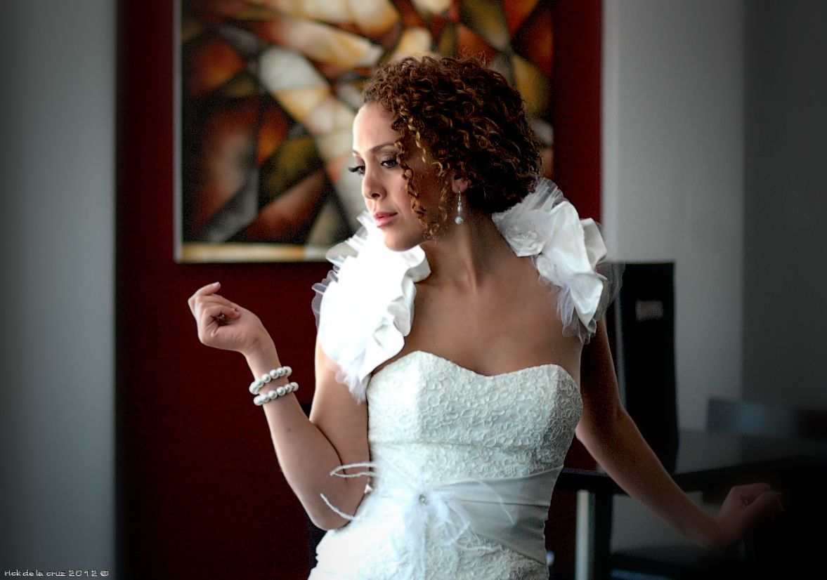 Wedding dres with a pleated shoulder wrap