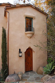 la-habra-stucco-for-a-mediterranean-exterior-with-a-tile-roof-and-el-volver-by-sterling-huddleson-ar
