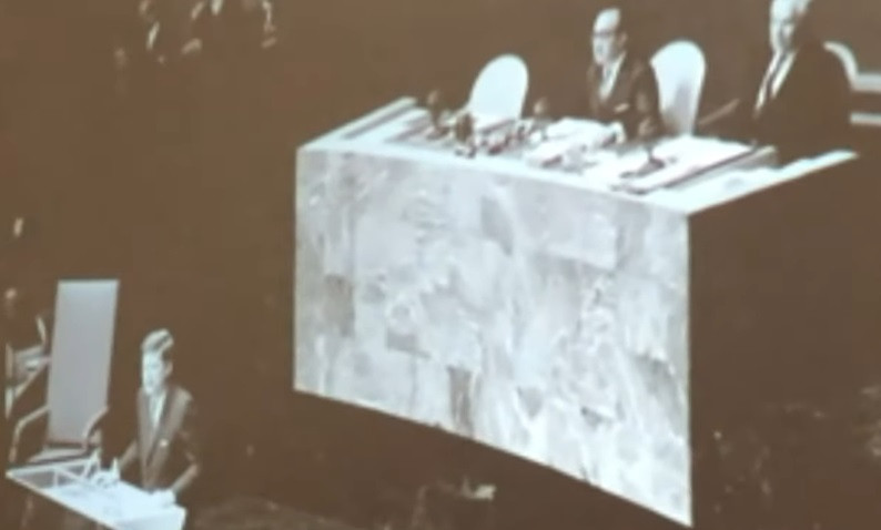 Kennedy speech at UN with large chair nearby