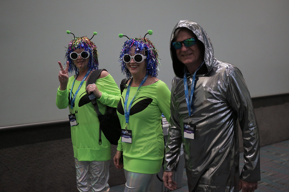Alien Con attendees dressed up as aliens