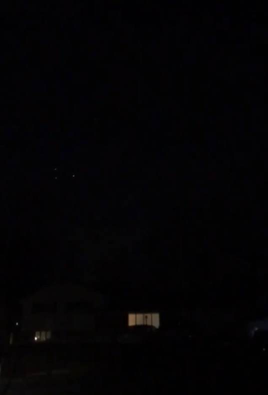 Triangle UFO glides across night sky