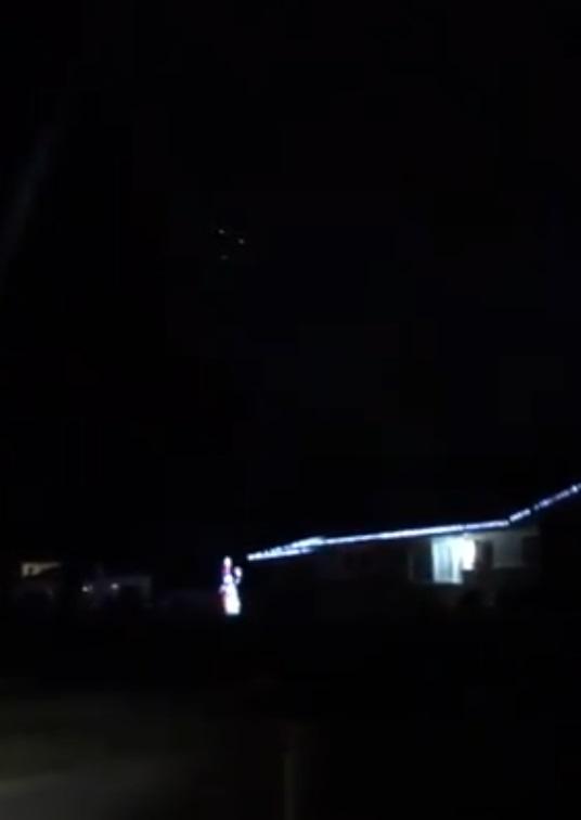 Triangle UFO appears over neighborhood
