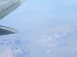 "Video Shows Silver ""Tic Tac"" UFO Flying Around Wing of Passenger Plane"