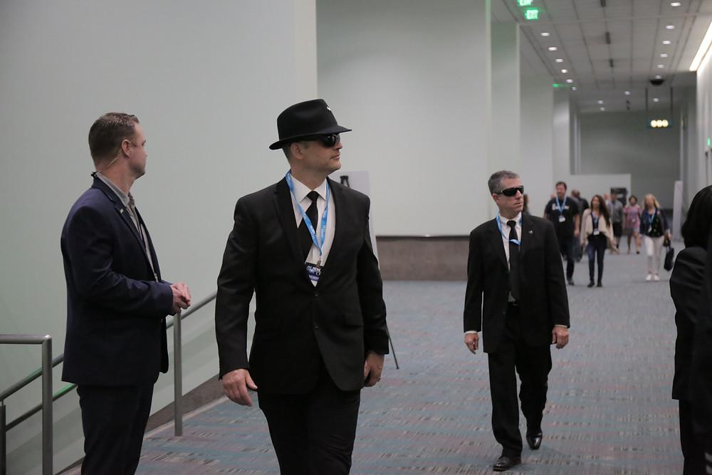men in black costumes