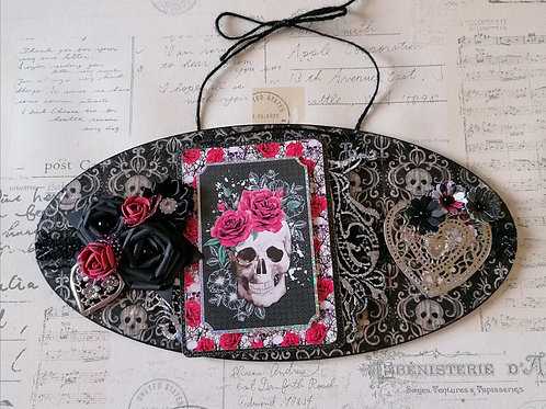 Skull decorated hanging plaque