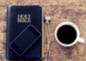 smartphone over the holy bible with bla