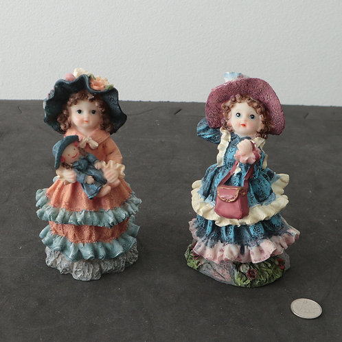 2 Statuettes