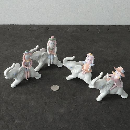 Collection de 4 bibelots éléphant et petite fille