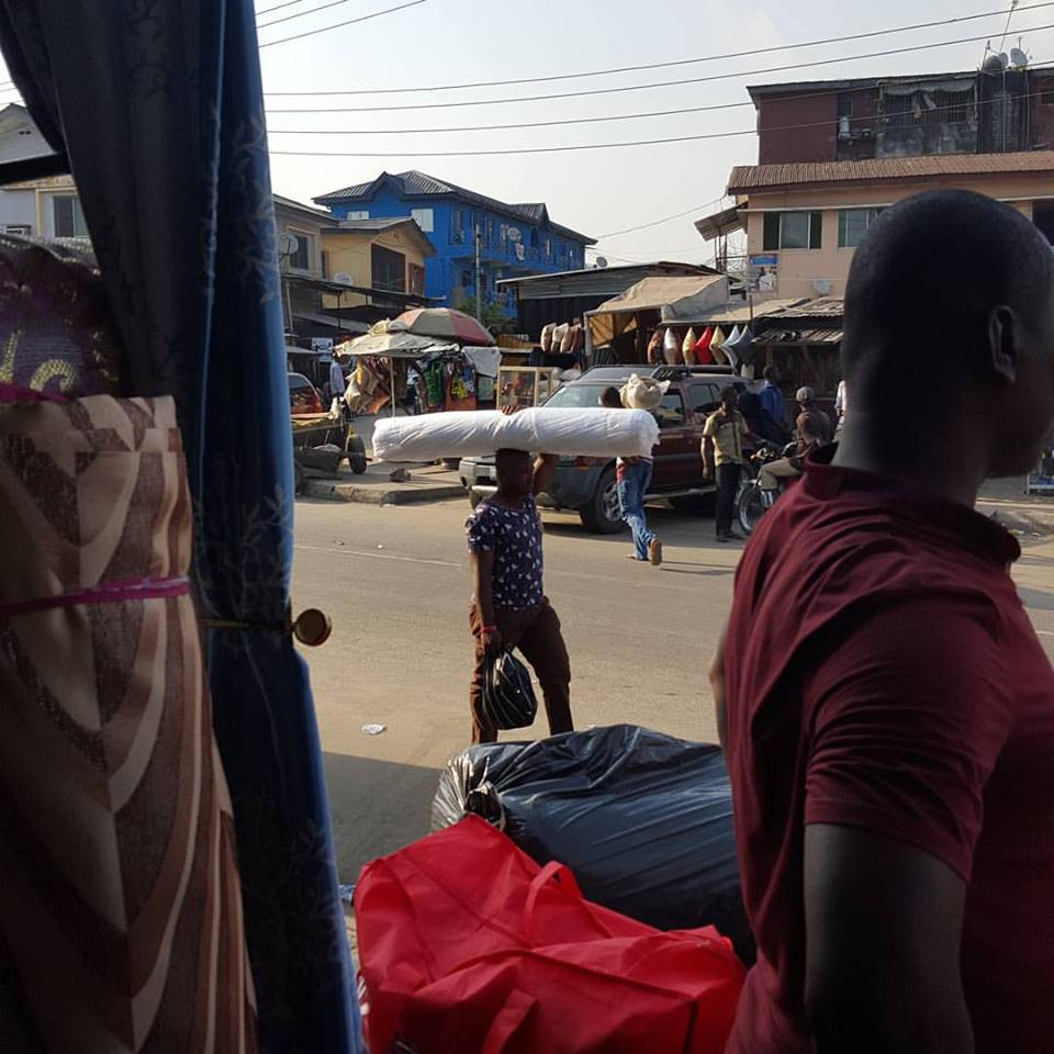 Near Surulere neighborhood in Lagos, Nigeria at a fabric market