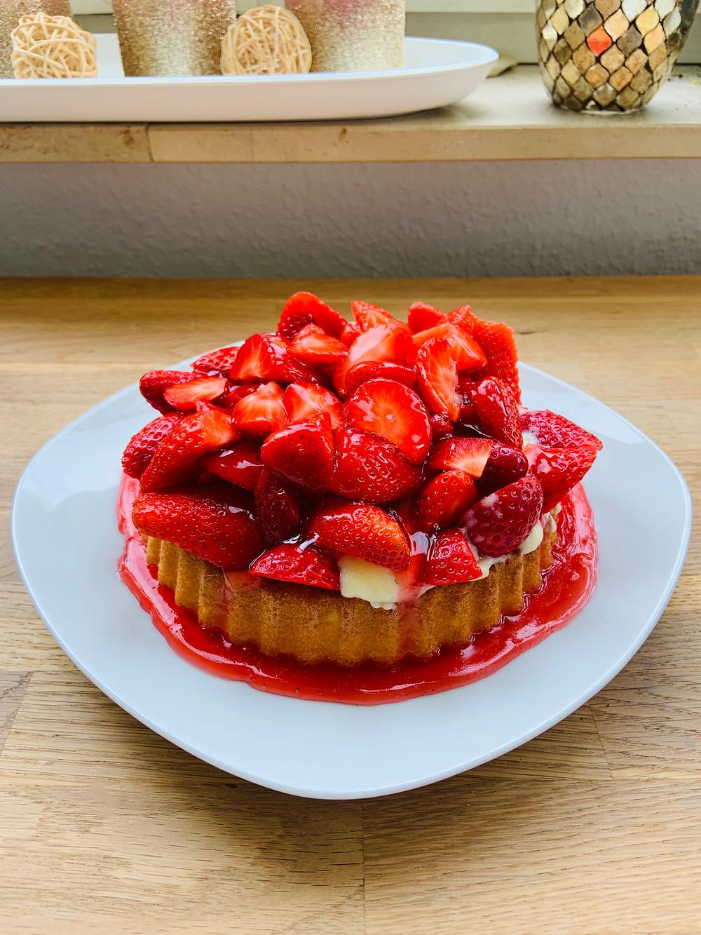 Vegan strawberry cake with whipped cream