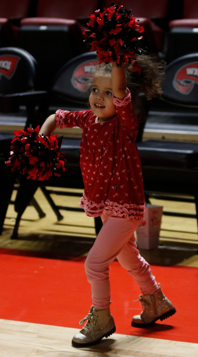 "Gracie, a 3 year old, spends time with her grandparents Michelle and Doug Gorman at Western Kentucky University Men's Basketball game last Thursday. ""Oh she wants to be a cheerleader so bad, or a dancer, either one, and hey maybe she'll come here,"" Michelle Gorman said."