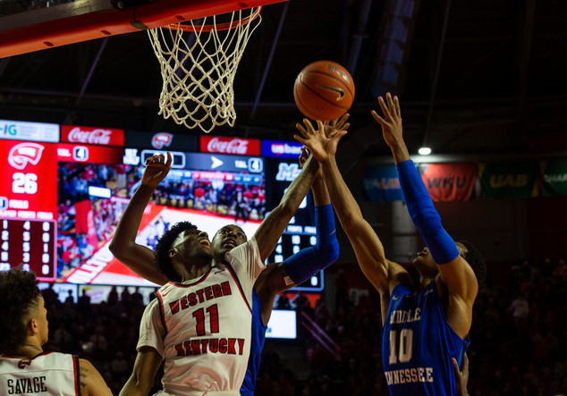 WKU Hilltoppers play against Middle Tennessee in a close win of 71 to 63. Taveion Hollingsworth, #11 guard, blocks opposing team's attempt of a lay up assist knocking away the risky shot.