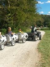 kids riding Brookdale Farms cow train