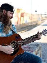 Dustin James Clark playing guitar