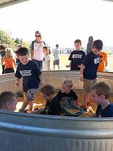 kids digging in large corn box at Brookdale Farms