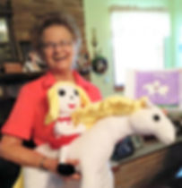 """WritesieBooks and WritesiePals bring joy to children of all ages. Meet one of Writesie's octogenarians and delighted WritesiePal fans.  She is holding a combination of two custom stuffed WritesiePals... a 16"""" custom stuffed selfie riding a 30"""" custom stuffed animal (horse). This WritesiePal combination was created from the 2D drawing shown just right of the custom plush WritesiePal."""