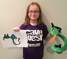 """This young lady is displaying her unique custom stuffed animal which she called a flying snake-dragon, complete with blue wings, black horns, green body and black, spiked tail.  Another one-of-a-kind 16"""" WritesiePal. This custom stuffed animal was created from the 2D picture shown left and below."""