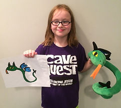 "This young lady is displaying her unique custom stuffed animal which she called a flying snake-dragon, complete with blue wings, black horns, green body and black, spiked tail.  Another one-of-a-kind 16"" WritesiePal. This custom stuffed animal was created from the 2D picture shown left and below."