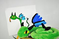 "Meet the ""Flying Snake-Dragon"", a one-of-a-kind 16"" WritesiePal. This custom stuffed animal was created from the 2D picture shown left and in back of the custom stuffed animal / WritesiePal."