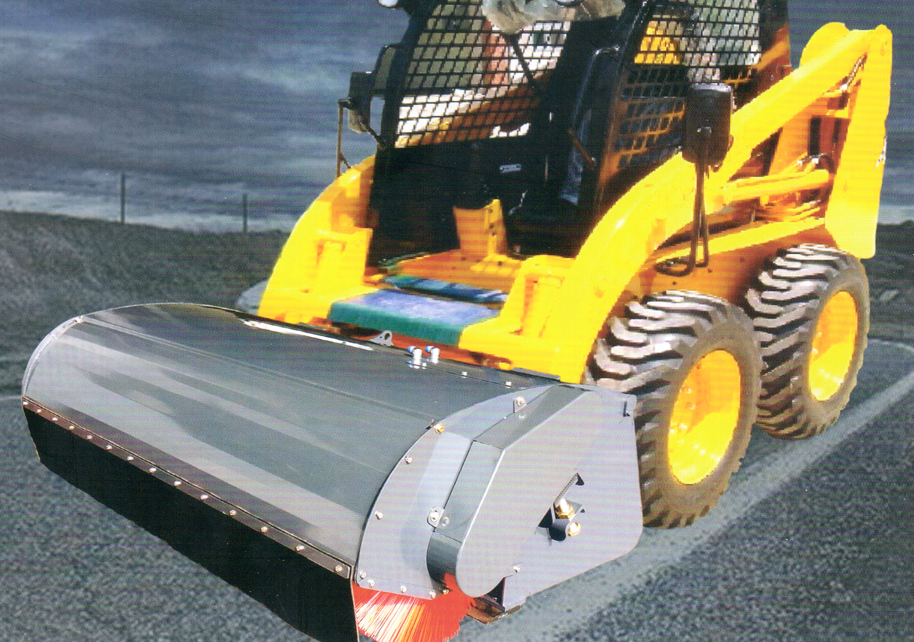 SKID LOADER SWEEPER 06