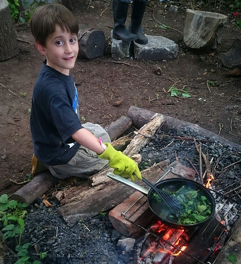 Cooking on the fire at the World Outside Nursery Kidderminster