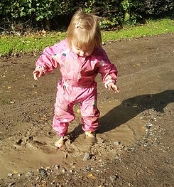 Child in a puddle The World Outside Kindergarten
