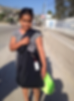 Migrant girl with backpack photo.png