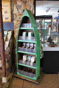 display that holds attraction brochures in the shape of a canoe