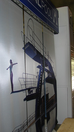 wall mural for a pool company of a swimmer on a high diving board