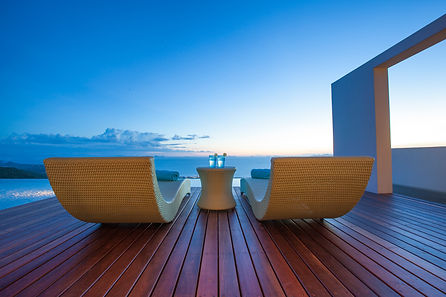 Sunloungers and cocktails overlooking sunset