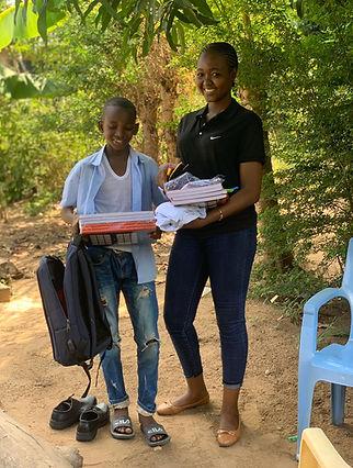 Salum with school supplies.JPG