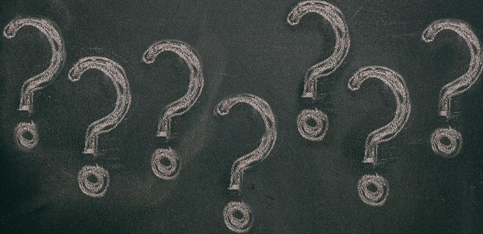 question-marks-chalk-drawing-on-blackboa