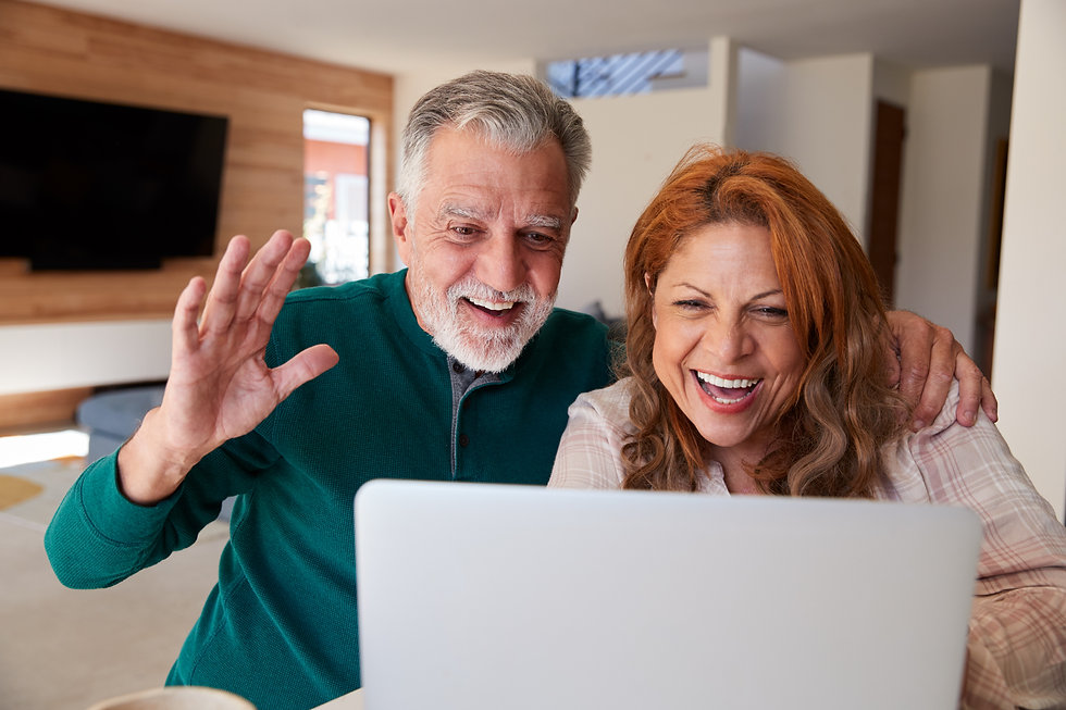 senior-hispanic-couple-at-home-with-lapt