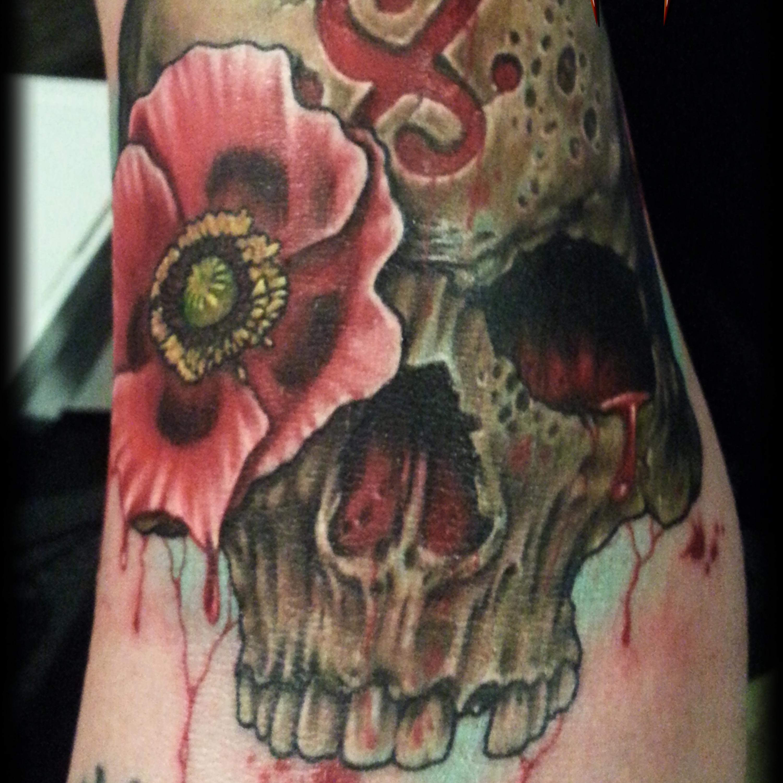 skull and poppy
