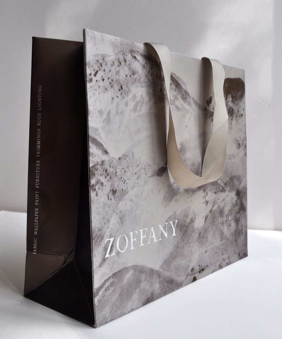 """An abstract interpretation of the """"Sansui"""" designand copper were used for the carrier bag that were key elements in the graphics for the collection. The carrier bag was printed using metallic inks and finished with silk lamination, silver foil and UV spot over-gloss, a reflection of the different textures and finishes presented in the collection."""