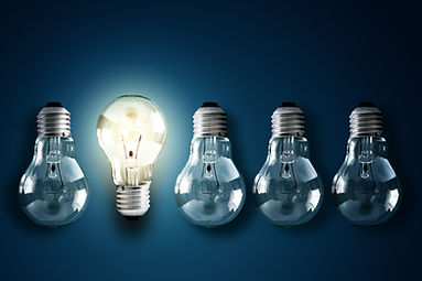 Illuminated light bulb in a row of dim o