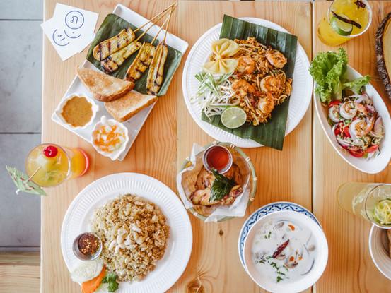 Clockwise: Satay, Pad Thai, 5-Herb Shrimp Salad, Tom Kha Chicken, Sriracha Wings, Crab Fried Rice