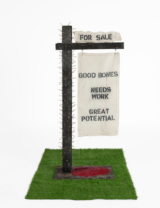 Yard Sign Series #1: America. For Sale? (2020), torched wood, nails, spray-paint, canvas, acrylic, latex, thread, charcoal, grass.