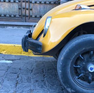 Yellow car in Cusco.jpg