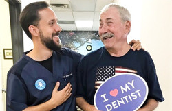 Happy Patient loving his teeth bleaching and whitening, painless root canal, and implant and veneer