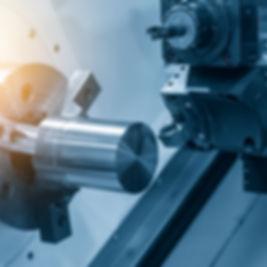 The  CNC lathe machine cutting the steel