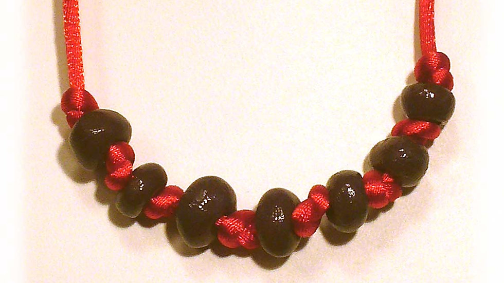 Brown beads on red string