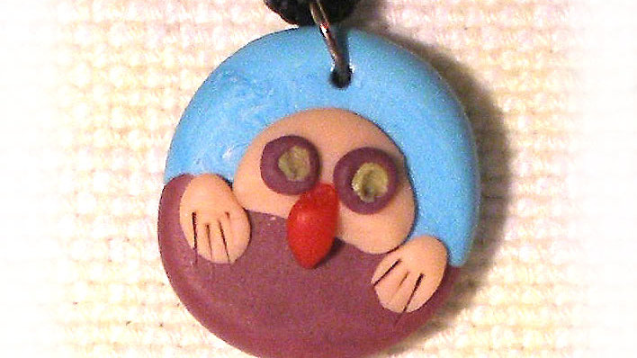 Funny face on string necklace