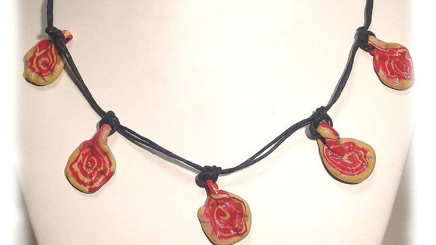 Red-yellow marble beads on string necklace