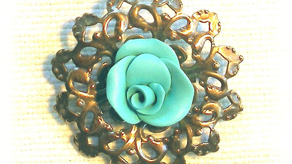 Blue rose on metal plate