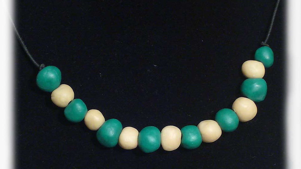 Green beads and white beads on string necklace