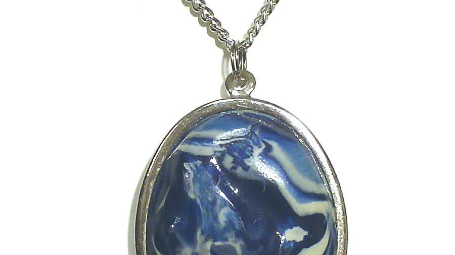 Blue marble pendent on metal plate