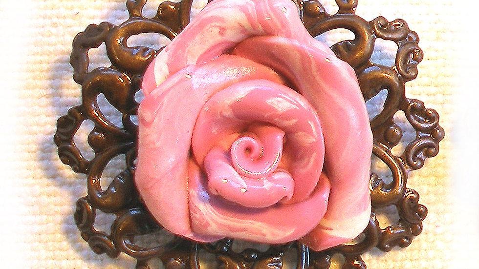 Pink-marble rose on metal plate