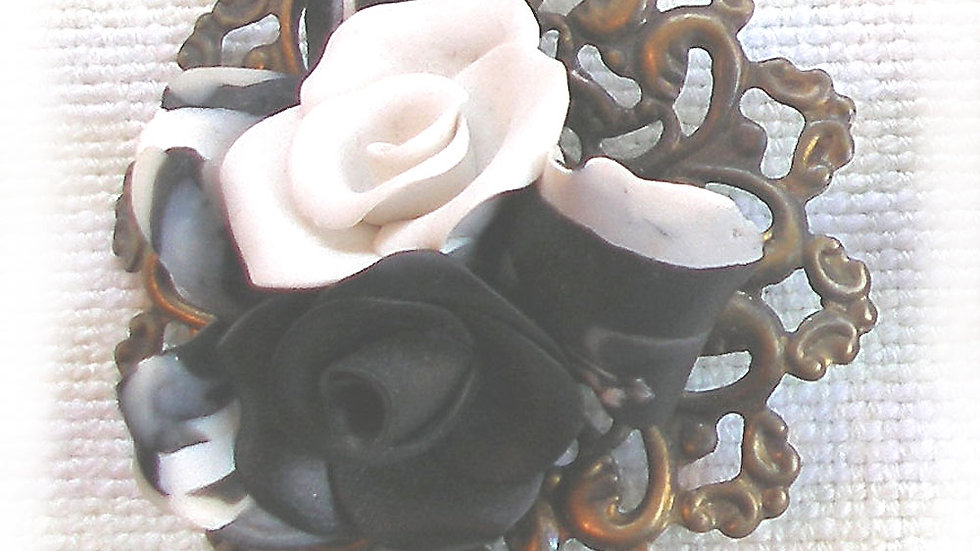 Black and white flowers on metal plate